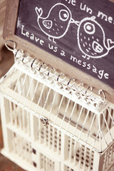 Birdcage for notes in a wedding day