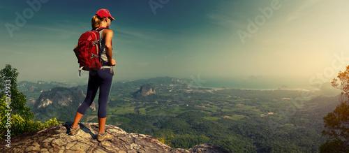 Leinwanddruck Bild Lady hiker on the mountain