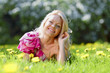 Woman laying on flower meadow