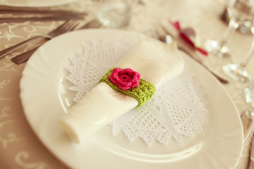 Green and fuchsia wedding napkin an table