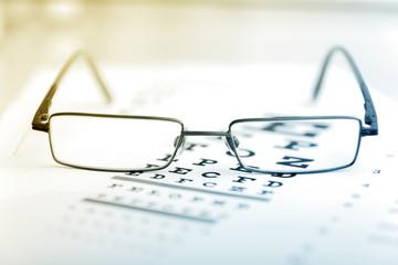 Clear Black modern glasses on a eye sight test chart