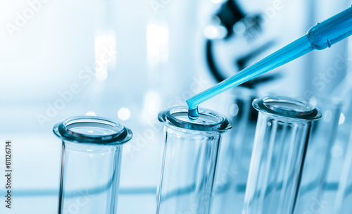 Pipette adding fluid to one of several test tubes . - 81126714