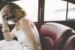 Elegant woman in vintage car - 81128762