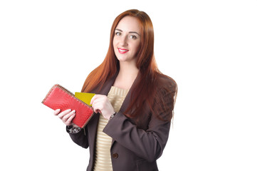 Redhead woman pulling credit card out of a red purse