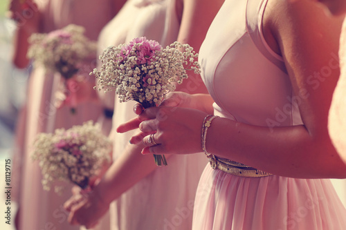 Hands of bridesmaid holding a beautiful gypsophila bouquet - 81129715