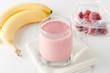 Leinwandbild Motiv homemade banana and frozen strawberry smoothie