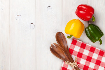 Colorful bell peppers and kitchen utensil