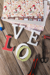 Scrapbook background with wooden LOVE letters