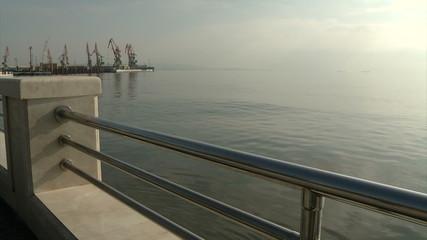 Sea, quay cranes and