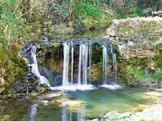 Waterfall by ancient Roman Bridge, Fornoli, Italy.