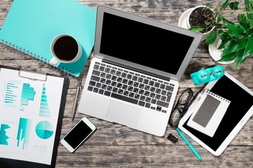 News. Financial business news online on a laptop with coffee and