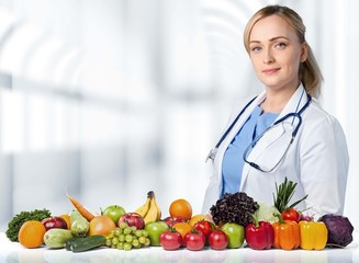 Healthy Eating. Excited woman with fruits and vegetables