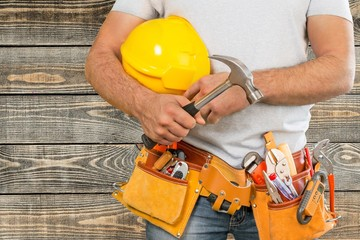 Adjustable. Handyman with a tool belt. House renovation service.
