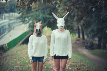 horse and rabbit mask young couple beautiful women girls