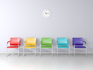 Five colored chairs in the waiting room