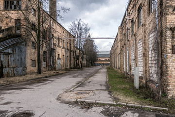 Old abandoned industrial street view with brick facades