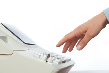 Sales persons hand  going to enter amount on cash register in re