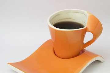 Orange modern cup, coffee and coffee beans