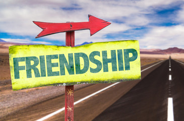 Friendship sign with road background