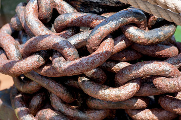 Rows of rusty chains. Heavy rusted metal chain