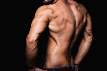 Muscular back and sexy torso of young man