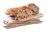 Fotoroleta Baguette, raisin bread, olive bread and breadsticks