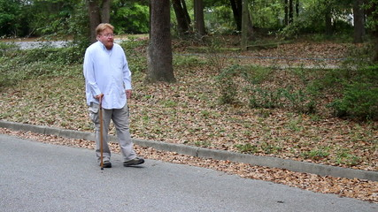 Disabled Man Using Cane