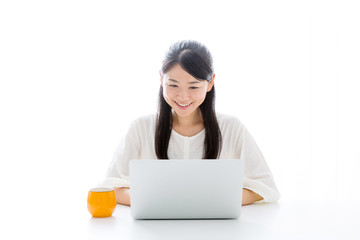 young asian woman using laptop