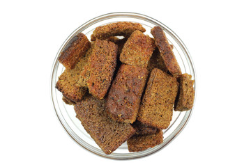 Rye crackers in glass cup on a white background