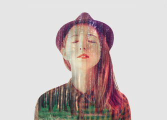 Double exposure portrait of beautiful girl with trees