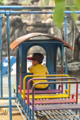 Boy playing alone in playground