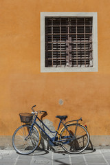Bicycle in old street in Pisa, Tuscany, Italy