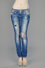 Body part, beautiful woman wearing jeans isolated on gray backgr