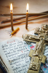 Christian still life with old metal cross and ancient book