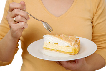 """Woman holds a plate with a piece of cake """"angel's tears"""""""