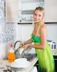 blonde housewife washing plates