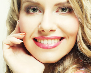 blond girl smiling and laughing