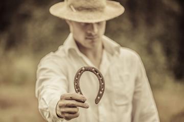 Lucky Farmer Holding a Horseshoe