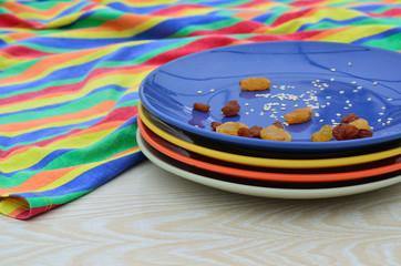 Raisins and sesame seeds on plates