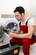Leinwanddruck Bild - Kundendienst, defekte Waschmaschine wird repariert