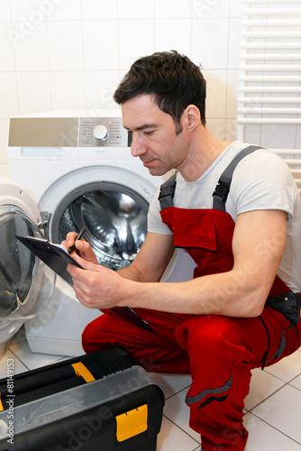 Leinwanddruck Bild Kundendienst, defekte Waschmaschine wird repariert