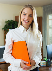 Positive woman in business outfit