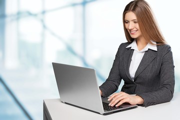 Network. Beautiful young lady sitting at desk and typing on