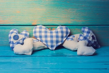 Oktoberfest. Different handmade blue hearts of fabric on a