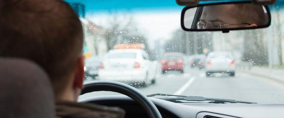 driver eyes car driving steering wheel city road inside view