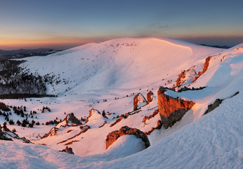 Frosty sunset panorama in beauty winter mountains
