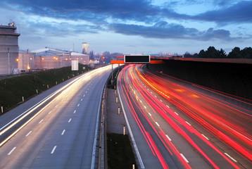 Speed Traffic at Dramatic Sundown Time - light trails on motorwa