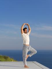 young man practicing yoga