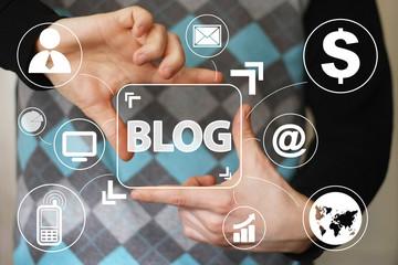 Businessman hand press web blog button virtual