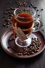Coffee drink in a glass with cinnamon and beans